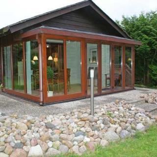 Blockhaus mit W-LAN und moderner Ausstattung - Blockhaus mit W-LAN und grossem Wintergarten - Damp