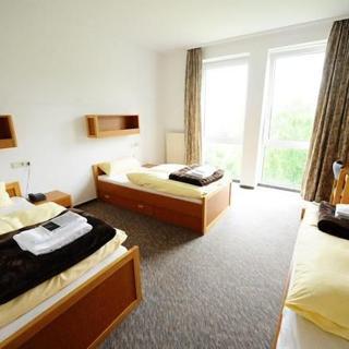 Buddhas Weg - Kloster/Seminar- und Gästehaus - 3-Bett-Zimmer Standard - Wald-Michelbach