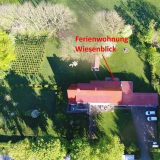 Ferienwohnungen Ramitz - Ferienwohnung Wiesenblick mit Kamin - Thesenvitz